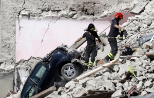 Rescuers make their way through destroyed houses following Wednesday's earthquake in Pescara Del Tronto, Italy, Thursday, Aug. 25, 2016. (AP Photo/Gregorio Borgia)