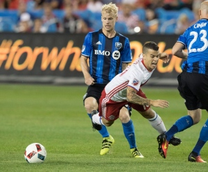 Toronto FC's Sebastian Giovinco (10) is taken down in front of Montreal Impact's goal during second half MLS soccer action in Toronto on Saturday, August 27, 2016. (Fred Thornhill / THE CANADIAN PRESS)