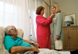 In this July 1992 file photo, Hillary Clinton's father Hugh watches as her mother Dorothy Rodham adjusts her daughter's clothing in a New York Hotel room during the Democratic National Convention. Hillary Clinton has landed on very personal argument against Donald Trump's checkered business past: her dad.  (AP Photo/Ron Frehm, File)