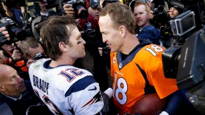 New England Patriots quarterback Tom Brady, left, and Denver Broncos quarterback Peyton Manning speak to one another following the NFL football AFC Championship game between the Denver Broncos and the New England Patriots, Sunday, Jan. 24, 2016, in Denver. (AP Photo/David Zalubowski)