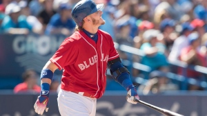 Toronto Blue Jays' Josh Donaldson watches his second home run leave the park in the seventh inning of their American League MLB baseball game against the Minnesota Twins in Toronto Sunday August 28, 2016. THE CANADIAN PRESS/Fred Thornhil