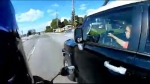 Motorcyclist films close call with driver