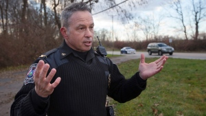 In this Dec. 18, 2015 file photo, the chief of police of the Newtown, Ohio, Police Department, Thomas Synan Jr., speaks to reporters at the scene of a traffic stop arrest in Newtown, Ohio. Synan Jr., who heads the Hamilton County Drug Coalition task force, said drug overdoses in the Cincinnati area dropped to 10 to 15 a day during the last weekend of August 2016, following a weeklong spike that exhausted emergency workers in the Cincinnati area and the neighboring states of Indiana, Kentucky and West Virginia. (John Minchillo/AP)