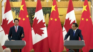 Prime Minister Justin Trudeau, left, speaks during a joint press conference with China's Premier Li Keqiang, right, at the Great Hall of the People in Beijing, Wednesday, Aug. 31, 2016. (AP / Mark Schiefelbein)