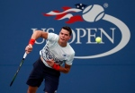 Milos Raonic, of Canada, serves to Ryan Harrison, of the United States, during the second round of the U.S. Open tennis tournament, Wednesday, Aug. 31, 2016, in New York. (AP / Alex Brandon)