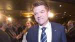 Alberta Wildrose Leader Brian Jean walks through the crowd after being declared the official opposition in Fort McMurray, Alta., on Tuesday May 5, 2015. Alberta's two conservative political leaders are not impressed by a weekend convention that voted to look at forming a third right-centre party. THE CANADIAN PRESS/Jason Franson