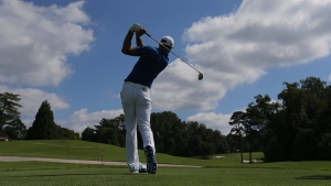 Dustin Johnson tees off on the sixth hole at East Lake Golf Club in Atlanta, on Sept. 20, 2016. (Curtis Compton / Atlanta Journal-Constitution via AP)