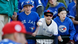 Toronto Blue Jays fans seek autographs before a baseball game against the Seattle Mariners, on Sept. 20, 2016. (Ted S. Warren / AP)
