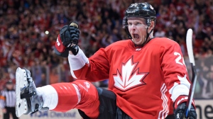 Team Canada's Corey Perry (24) celebrates his goal against Team Russia during third period World Cup of Hockey semifinal action in Toronto on Saturday, September 24, 2016. THE CANADIAN PRESS/Nathan Denette