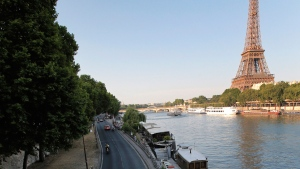 The road along the Seine river, with the Eiffel Tower at right, in Paris, is seen on July 21, 2013. (Christophe Ena / AP)