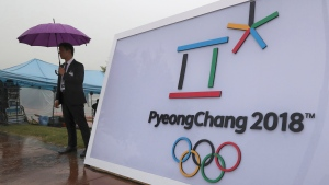 Security personnel stands by a logo of the 2018 PyeongChang Olympic Winter Games before an event to mark the start of the 500-day countdown in Seoul, South Korea, Tuesday, Sept. 27, 2016. (AP Photo/Lee Jin-man)