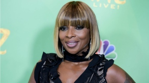 "In this June 1, 2016 file photo, Mary J. Blige attends ""The Wiz Live!"" Photo Op held at the Directors Guild of America in Los Angeles. A pair of clips teasing Blige's interview with Hillary Clinton on her upcoming Apple Music show ""The 411"" isn't winning over social media users. (Richard Shotwell/AP)"