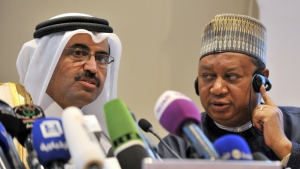 Acting Secretary General of OPEC Mohammed Barkindo, right, looks at Minister of Energy and Industry of Qatar, Bin Saleh Al-Sada, during a closing press conference at the end of meeting of oil ministers of the Organization of the Petroleum Exporting countries, OPEC, in Algiers, Algeria on Wednesday, Sept. 28, 2016. (AP / Sidali Djarboub)