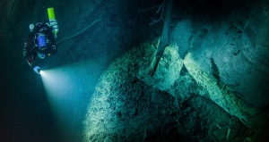 Polish explorer Krzysztof Starnawski is seen in this underwater photo taken Aug. 15, 2015 in the flooded Hranicka Propast, or Hranice Abyss, in the Czech Republic. He is seen exploring the limestone abyss and preparing for deeper exploration with the use of a remotely-operated underwater robot, or ROV. (Krzysztof Starnawski of EXPEDITION via AP)