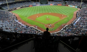 In this file photo, a fan watches an Atlanta Braves baseball game at Turner Field in Atlanta on Sept. 28, 2016. (AP / John Amis)