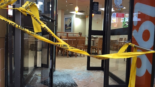 Police tape is shown in this image from the scene of a fatal shooting inside a Pizza Pizza in Weston on Oct. 16, 2016. (Arda Zakarian/CP24)