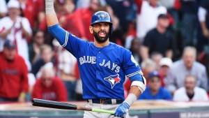 Toronto Blue Jays right fielder Jose Bautista (19) reacts at the plate against the Cleveland Indians during third inning, game two American League Championship Series baseball action in Cleveland on Saturday, Oct. 15, 2016. (The Canadian Press/Nathan Denette)