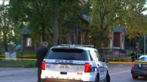 A detective is shown at the scene of a fatal shooting in Mississauga on Saturday morning.