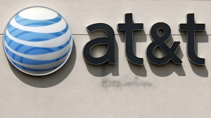 This May 14, 2014 file photo shows an AT&T logo on a store in Dedham, Mass. (AP / Steven Senne, File)
