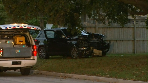 A Range Rover SUV with a crumpled hood is pictured at the scene where a man was found with gunshot wounds on Windsor Road in Etobicoke on Monday on Oct. 24, 2016.
