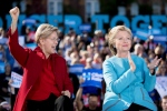 Democratic presidential candidate Hillary Clinton, accompanied by Sen. Elizabeth Warren, D-Mass., applauds on stage at a rally at St. Anselm College in Manchester, N.H., Monday, Oct. 24, 2016. (AP / Andrew Harnik)