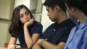 In this July 7, 2016, photo, Evee Bak, left, talks with her brother Tom Bak while they wait to talk with reporters at the Seaver Autism Center at Mount Sinai Hospital in New York. (AP / Seth Wenig)