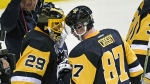 Pittsburgh Penguins center Sidney Crosby (87) congratulates goalie Marc-Andre Fleury (29) after the Penguins defeated the Florida Panthers 3-2 in an NHL hockey game on Tuesday, Oct. 25, 2016, in Pittsburgh. (AP / Fred Vuich)