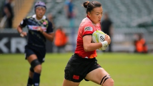China's Chen Keyi, right, playing rugby on Nov. 8, 2015. (Vincent Yu / AP)