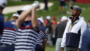 Tiger Woods watches at the Ryder Cup golf tournament on Sept. 29, 2016. (Chris Carlson / AP)
