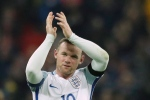 England's Wayne Rooney claps after winning the World Cup group F qualifying soccer match between England and Scotland with a 3-0 score at the Wembley stadium, London, on Friday, Nov. 11, 2016. (AP Photo/Matt Dunham)