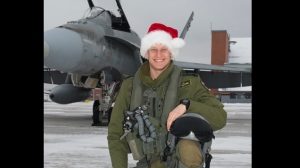 Capt. Thomas McQueen, pictured in front of his CF-18 in an RCAF photo from December, 2014. (Cpl. Elena Vlassova/Department of National Defence)