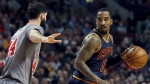 Cleveland Cavaliers guard J.R. Smith, right, looks to pass as Chicago Bulls forward Nikola Mirotic defends during the first half of an NBA basketball game Friday, Dec. 2, 2016, in Chicago. (AP / Nam Y. Huh)