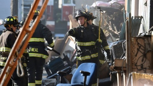 Firefighters assess the scene where a deadly fire tore through a late-night electronic music party in a warehouse in Oakland, Calif., Saturday, Dec. 3, 2016. Officials described the scene inside the warehouse, which had been illegally converted into artist studios, as a death trap that made it impossible for many partygoers to escape the Friday night fire. (AP Photo/Josh Edelson)