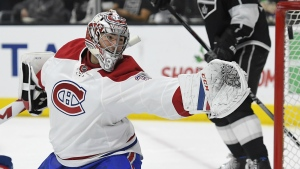 Montreal Canadiens goalie Carey Price reaches for the puck as it flies past the goal during the second period of an NHL hockey game against the Los Angeles Kings in Los Angeles on Sunday, Dec. 4, 2016. (AP / Mark J. Terrill)