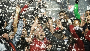 Toronto FC midfielder Michael Bradley reacts with the trophy after defeating the Montreal Impact during overtime MLS eastern conference playoff soccer final action in Toronto on Wednesday, Nov. 30, 2016. (Nathan Denette / THE CANADIAN PRESS)