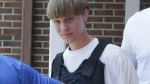 Dylann Storm Roof is escorted from the Sheby Police Department in Shelby, N.C. on June18, 2016. (AP / Chuck Burton)