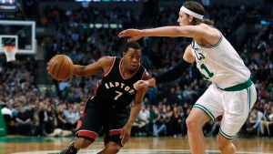 Toronto Raptors' Kyle Lowry (7) drives on Boston Celtics' Kelly Olynyk during the second half of an NBA basketball game in Boston Friday, Dec. 9, 2016. (AP Photo / Winslow Townson)
