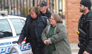 Elizabeth Wettlaufer is escorted into the courthouse in Woodstock, Ontario on Friday, Jan. 13, 2017. Ontario Provincial Police laid six more charges against 49-year-old Wettlaufer, four counts of attempted murder and two counts of aggravated assault. (THE CANADIAN PRESS/Dave Chidley)