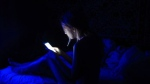 One in five teens are waking up in the night to use social media, affecting both their sleep and happiness suggests new research. (sapozhnik / Istock.com)