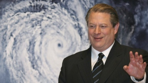 "In this Jan. 15, 2007 file photo, former U.S. Vice President Al Gore acknowledges spectators in front of a poster of his starring documentary film ""An Inconvenient Truth"" on global warming before its screening during the Japan Premier at a theater in Tokyo. (AP / Koji Sasahara, File)"