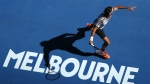 Switzerland's Roger Federer casts a shadow on the court as he plays a forehand return to United States' Noah Rubin during their second round match at the Australian Open tennis championships in Melbourne, Australia, Wednesday, Jan. 18, 2017. (AP / Dita Alangkara)