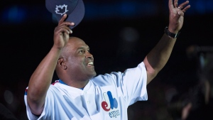 Former Montreal Expos outfielder Tim Raines salutes the crowd in Montreal, on April 1, 2016. (Paul Chiasson / THE CANADIAN PRESS)