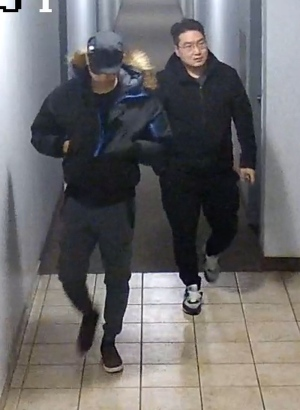 Two suspects wanted in connection with a home invasion at a Kennedy Road apartment are shown in this surveillance camera image. (Toronto Police Service)