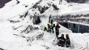 Italian firefighters search for survivors after an avalanche buried a hotel near Farindola, central Italy on Thursday, Jan. 19, 2017. (Italian Firefighters / ANSA)