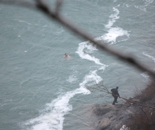 Rescue teams attempt to extract the man after he went over Horseshoe Falls in Niagara Falls, Ont., on Wednesday, March 11, 2009. (Phillip Richmond)