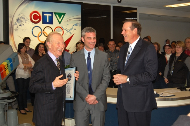 Dave Devall is presented with a certificated by the Guinness Book of World Records for 'longest career as a weather forecaster' during a ceremony at CTV on Friday, April 3, 2009. (Jamie Patterson / ctvtoronto.ca)