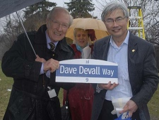 Coun. Chin Lee (right) presents Dave Devall with a 'Dave Devall Way' sign on Friday, April 3, 2009.