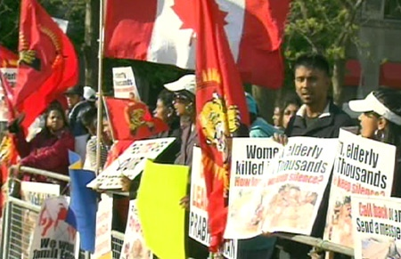 Tamil-Canadians protesters demonstrate outside the U.S. Consulate in Toronto, Tuesday, May 19, 2009.