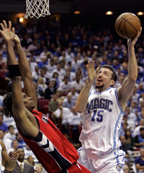 Orlando Magic forward Hedo Turkoglu (15), of Turkey, makes a shot in front of Toronto Raptors forward Chris Bosh during the second half of Game 2 in an NBA Eastern Conference playoff basketball series in Orlando, Fla., Tuesday, April 22, 2008. (AP / John Raoux)