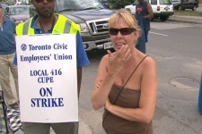 Residents voice their frustration with striking civic workers outside a city-run waste transfer site on July 12, 2009.